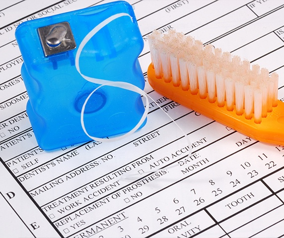 Dental patient forms with floss and toothbrush