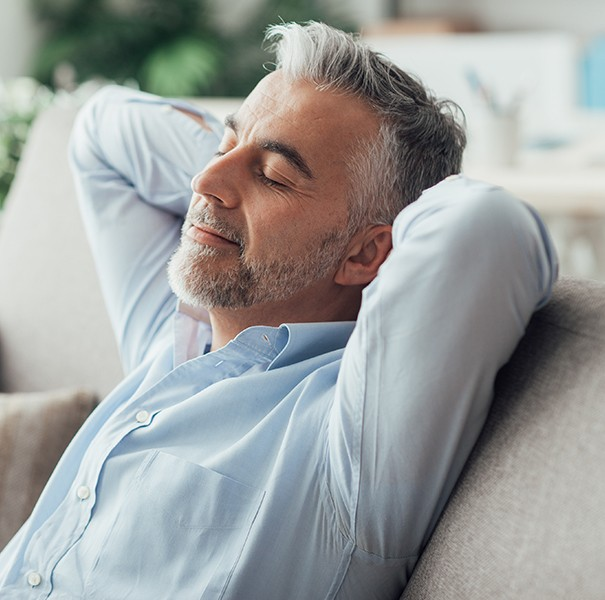 Man relaxing after sedation dentistry visit